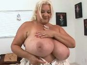 Fat mature woman in peignoir shows her huge boobs