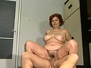 Horny busty granny rides young cock