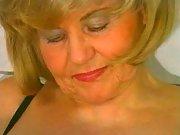 Grandma in a wig blows cock in bath