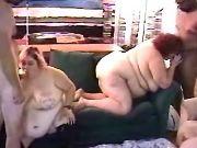Three chubby girls suck big cocks in wild orgy