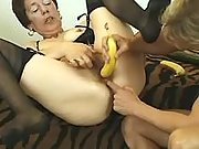 Aged woman with banana in her pussy