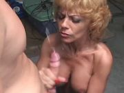 Chesty mature in stockings gets cum after fuck