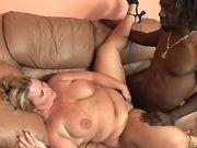 Black stud fucks fat mature on sofa