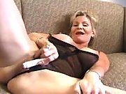 Naughty busty grandma fucks on sofa