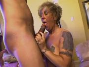 Aged tattooed mature sucking cock