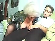 Aged grandma fucks on leather sofa