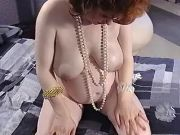 Busty pregnant mom shows her paunch in bedroom