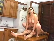 Busty fatty fucked on kitchen table