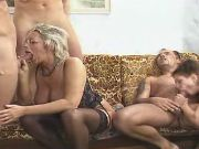 Spoiled granny in stockings sucks cocks in orgy