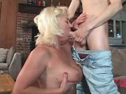 Chesty blonde granny spoils amateur dude on sofa