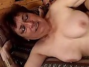 Paunchy brunette mom fucks on sofa
