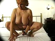 Busty granny dildoing wrinkled cunt