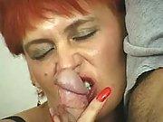 Redhead mom sensually slobbers cock