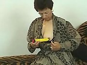 Brunette granny enjoying two dildos