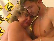 Curly fat granny sucks and titfucks