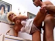 Senior slut in sexy lingerie takes rod from behind