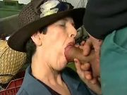 Glamour old lady deep throats fat cock in workshop