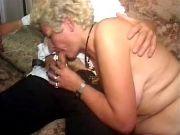 Kinky granny in stockings sucks hard cock of guy