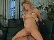 Stud drills pregnant beauty on sofa