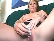 Lovely mature strips and rubs pussy