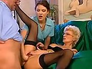 Tempting blonde mature in FFM orgy