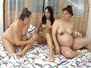 Pregnant lesbians caress each other in groupsex
