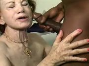 Lustful grandma gets cum by black man on face