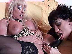 Mature lesbians select black dildo