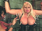 She feels the pain from the clamps on her tits