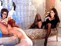 Three beautiful lesbians in stockings enjoy dildo