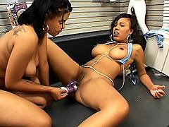 Ebony lesbian girls in a sex-shop