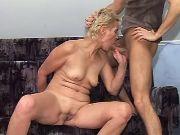 Blonde granny greedily sucking fresh cock in home