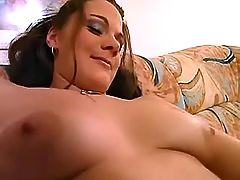Sexy lezzie licks another on sofa
