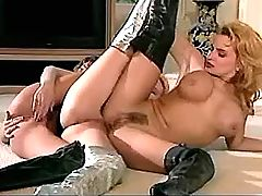 Sexual lesbians in high latex boots relax on floor