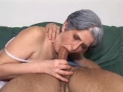 Lusty granny sucking cock of amateur guy on sofa