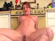 Some hardcore mature porn going on in the kitchen