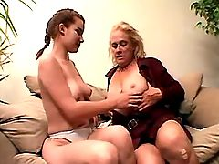 Granny lesbian spoils chick on sofa