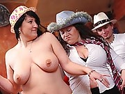 The blonde BBW with a big belly wears a hat and glasses and has sex with two guys