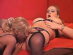 Blonde licks pussy of busty lesbian