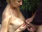 Blonde grandma gets cumload on big tits outdoor