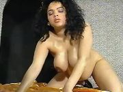 Pregnant latina babe plays in bed
