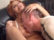 Redhead granny seduces amateur guy on leather sofa