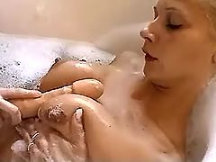 Cute young lesbians relax with sextoys in bath