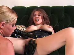 Blond lesbian in latex gloves caresses asian chick