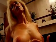 Sexy mature blonde stripping for her lover